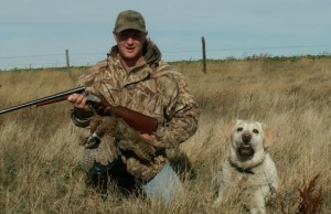 "The author and Labrador on an earlier hunt before ""Poacher"" was retired from service."